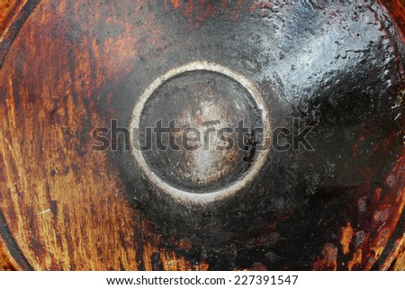 Sooty pan. Charred metal surface with scratches. - stock photo