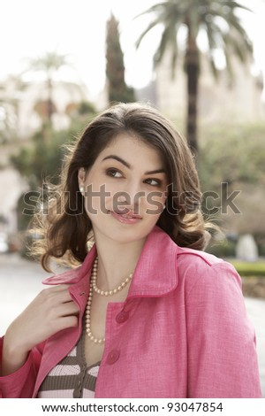 Sophisticated young woman looking away from the camera. - stock photo
