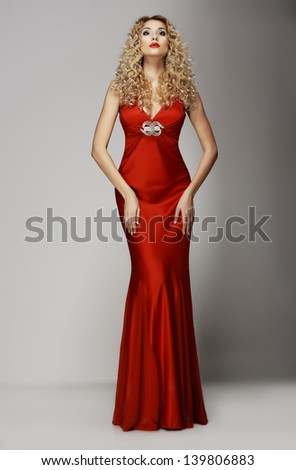 Sophistication. Seductive Woman in Red Fashion Dress. Charisma - stock photo