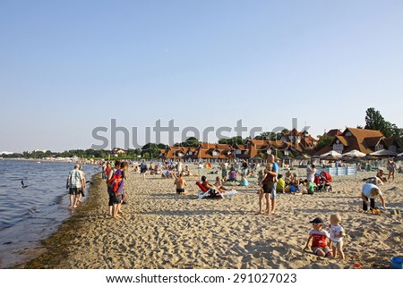 SOPOT, POLAND - JULY 26, 2012: Crowded Municipal beach in Sopot, Baltic sea, Poland - stock photo