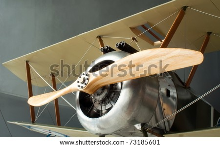 Sopwith Camel Biplane Propeller Machine Guns and Nose Cone in Museum Setting - stock photo