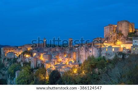 Sorano - tuff city in Tuscany. Italy. View in the dusk with illumination, travel background - stock photo