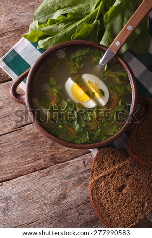 sorrel soup close-up on the table. vertical view above, rustic style - stock photo