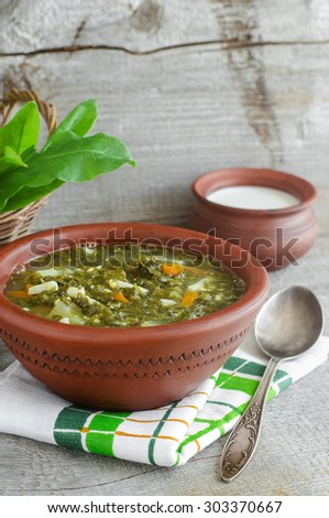 Sorrel soup in a clay bowl - stock photo