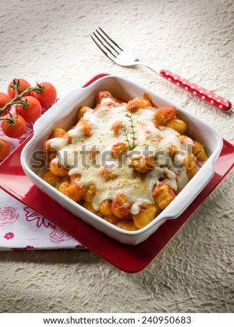sorrentina gnocchi with mozzarella and tomato - stock photo