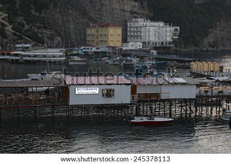SORRENTO, ITALY - OCTOBER 8 2014: The port of Marina Grande at dusk. This ancient gateway to the city now contains numerous restaurants for tourists and still serves as an active base for fishermen. - stock photo