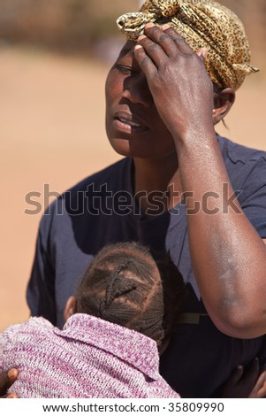 sorrow mother the kid is hugging her to make her feel better - stock photo