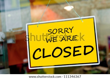 sorry we are closed sign hanging on a window door outside a restaurant, store, office or other - stock photo