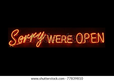 Sorry were open neon signage - stock photo