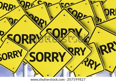 Sorry written on multiple road sign - stock photo