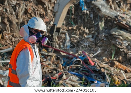 Sort industrial waste on a landfill - stock photo