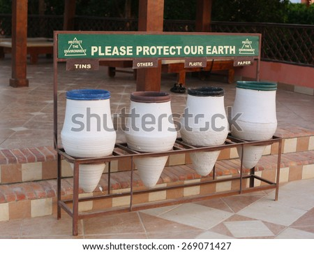 sort waste garbage bins in hotel resort to keep environment clean - stock photo