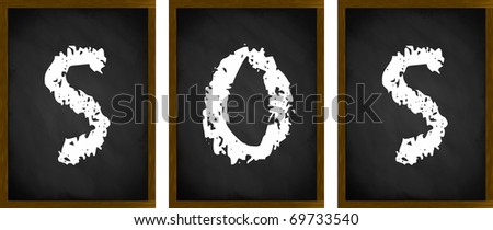 SOS sign on a series of framed blackboards - stock photo