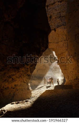 SOSSUSVLEI, NAMIBIA - NOVEMBER 2 2013: Tourists explore Sesriem Canyon a Geological Feature in the Namib Desert during a year that was declared as a drought year by the government in Namibia, Africa - stock photo