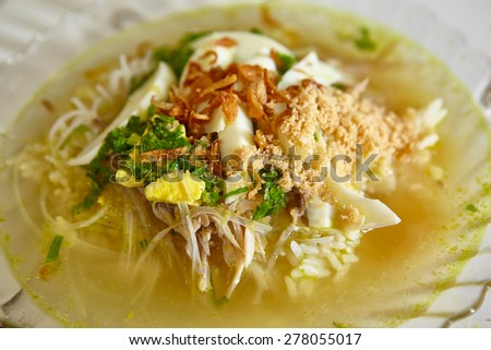Soto, one of traditional Indonesia chicken soup with many herbs and spices - stock photo