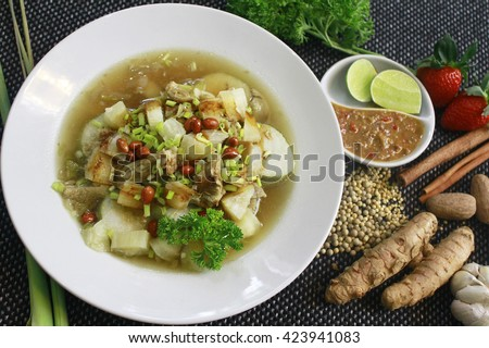 Soto Sabrang. Soto is a traditional Indonesian soup, Composed of broth, meat & vegetables. Soto Sabrang originally from Madura. Sabrang means Singkong in Bahasa, & Cassava in English. Medium top view. - stock photo