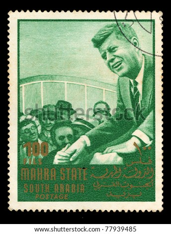 SOUDI ARABIA - CIRCA 1967: A stamp printed in Mahra State of Saudi Arabia shows a leader with supporters, circa 1967 - stock photo