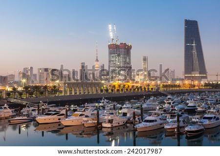Souk Sharq Marina and Kuwait City at dusk - stock photo