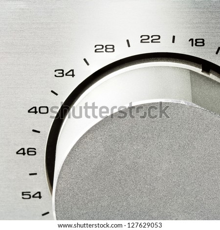 Sound amplifier. Volume knob close up. - stock photo