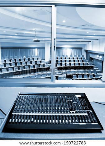 sound board and microphones in the conference hall - stock photo