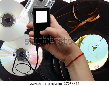 Sound carrier of the past times and player MP3 - stock photo
