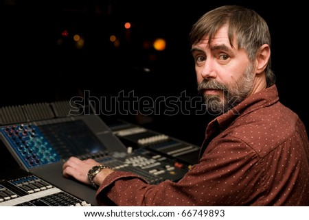 Sound engineer for sound mixer console in a nightclub. - stock photo