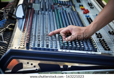 Sound engineer works with sound mixer, hands close-up  - stock photo