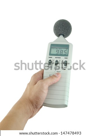 sound level meter holding on hand - stock photo