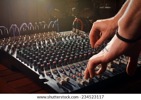 sound mixer in action, hand  - stock photo