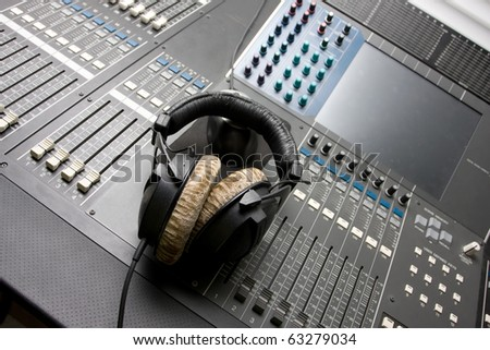 sound mixing console with headphones - stock photo