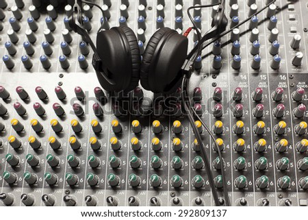 sound studio adjusting record equipment.   switching and transmission of sound - stock photo