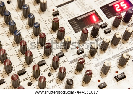 Sound studio record equipment with faders and adjusting knobs - stock photo
