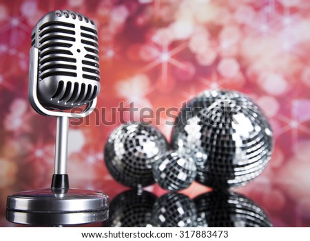 Sound waves, Microphone with disco balls - stock photo