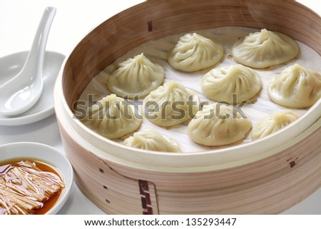 soup dumplings, xiaolongbao, xiao long bao, chinese food - stock photo