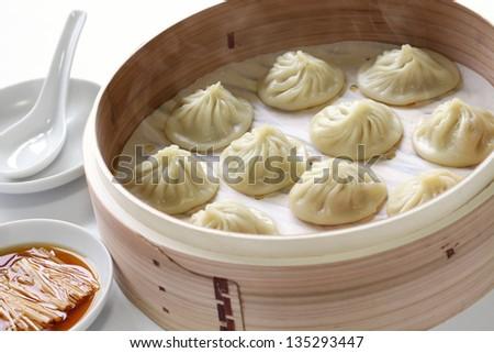 soup dumplings, xiaolongbao, xiao long bao, chinese food - stock photo