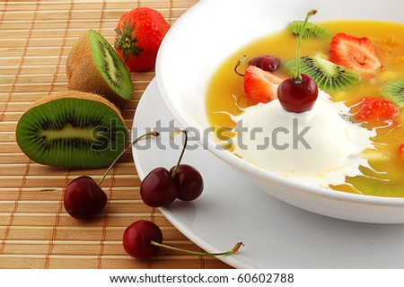 Soup from fruit and berries close up on a straw napkin - stock photo
