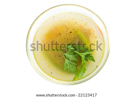 Soup in glass plate on white ground - stock photo