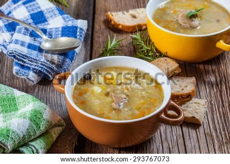Soup of porridge on a wooden table. - stock photo