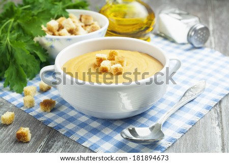 Soup of red lentils with croutons in the bowl - stock photo