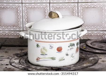 Soup pot on the wood-burning heating stove - stock photo