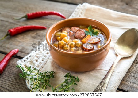 Soup with chickpeas and smoked sausage - stock photo