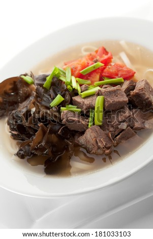 Soup with Chinese Noodles, Tomato, Beef, Onions and Mushrooms - stock photo