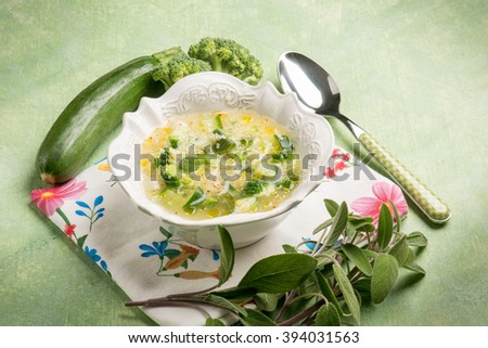 soup with couscous zucchinis and broccoli - stock photo