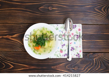 soup with spoon and napkin on dark table. flat lay. top view - stock photo