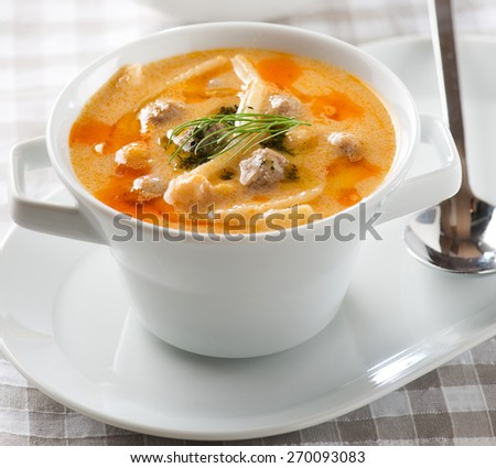 Soup with turkey meatballs, potatoes and vegetables - stock photo