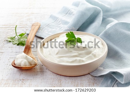 sour cream in a bowl - stock photo