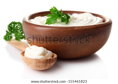Sour cream in bowl isolated on white - stock photo