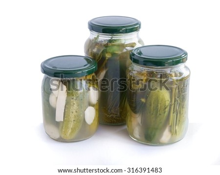 sour cucumber as salad and preserve - stock photo