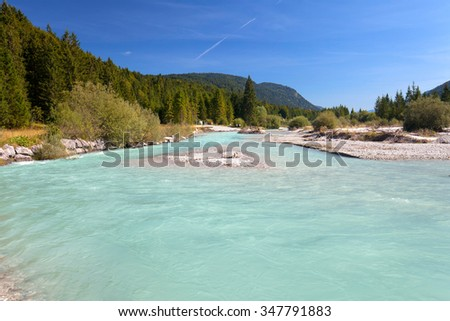 source of river isar, riverbed in the wilderness, view to karwendel mountains - stock photo