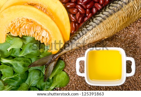 Sources of omega 3 fatty acids: flaxseeds, fat fish, field lettuce, pumpkin and pumpkin seeds, olive oil and kidney beans - stock photo
